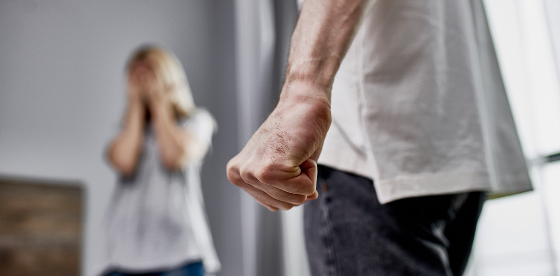 Man with Clenched Fist and Crying Woman
